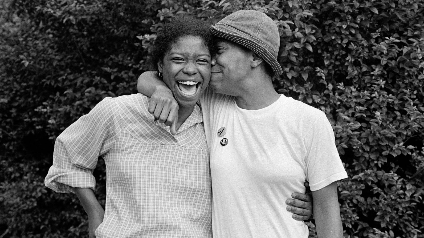 Black and white image of two women embracing and smiling